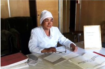 Gulmira Abduqodirova, Director of the Lyakhsh District TB Center, proudly displays the certificate recognizing her as the best TB nurse in Tajikistan.