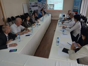 Group of civil society activists at meeting with Michael Kazatchkine